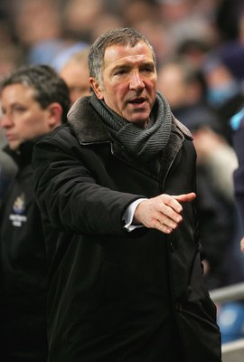 MANCHESTER, UNITED KINGDOM - FEBRUARY 01:  Graeme Souness of Newcastle United put out his hand at the end of the Barclays Premiership match between Manchester City and Newcastle United at the City Of Manchester Stadium on February 1, 2006, in Manchester,