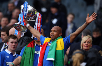 GLASGOW, SCOTLAND - MARCH 20:  El Hadji Diouf of Rangers celebrates winning over Celtic during the Co-operative Insurance Cup final between at Hampden Park on March 20, 2011 in Glasgow, Scotland.  (Photo by Julian Finney/Getty Images)