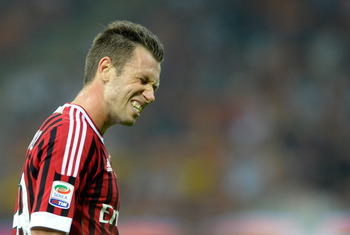 MILAN, ITALY - SEPTEMBER 09:  Antonio Cassano of AC Milan dejected during the Serie A match between AC Milan and SS Lazio at Stadio Giuseppe Meazza on September 9, 2011 in Milan, Italy.  (Photo by Claudio Villa/Getty Images)