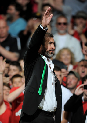 MANCHESTER, ENGLAND - AUGUST 05:  New York Cosmos Manager Eric Cantona salutes the fans at the end of Paul Scholes' Testimonial Match between Manchester United and New York Cosmos at Old Trafford on August 5, 2011 in Manchester, England.  (Photo by Chris