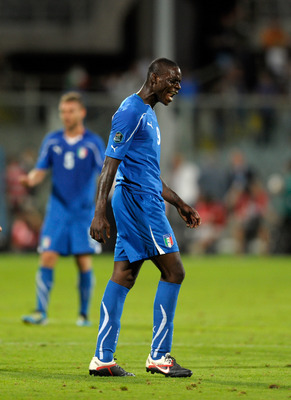 FLORENCE, ITALY - SEPTEMBER 06:  Mario Balotelli of Italy reacts during the EURO 2012 Qualifier match between Italy and Slovenia at Stadio Artemio Franchi on September 6, 2011 in Florence, Italy.  (Photo by Claudio Villa/Getty Images)