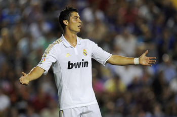 VALENCIA, SPAIN - SEPTEMBER 18:  Cristiano Ronaldo of Real Madrid reacts after missing a chance to score during the La Liga match between Levante UD and Real Madrid CF at Ciutat de Valencia Stadium on September 18, 2011 in Valencia, Spain. Levante UD won