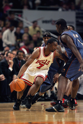 CHICAGO - APRIL 24:  Ben Gordon #7 of the Chicago Bulls moves the ball against Kwame Brown #5 of the Washington Wizards in game one of the Eastern Conference Quarterfinals  during the 2005 NBA Playoffs at the United Center on April 24, 2005 in Chicago, Il