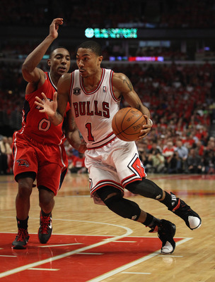 CHICAGO, IL - MAY 10: Derrick Rose #2 of the Chicago Bulls drives past Jeff Teague #0 of the Atlanta Hawks in Game Five of the Eastern Conference Semifinals in the 2011 NBA Playoffs at the United Center on May 10, 2011 in Chicago, Illinois. The Bulls defe