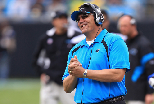 CHARLOTTE, NC - SEPTEMBER 18:  Head coach Ron Rivera of the Carolina Panthers reacts to a call against the Green Bay Packers during their game at Bank of America Stadium on September 18, 2011 in Charlotte, North Carolina.  (Photo by Streeter Lecka/Getty I