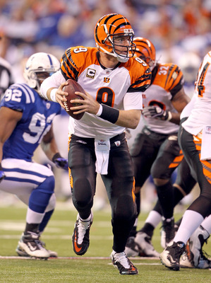 INDIANAPOLIS - NOVEMBER 14:  Carson Palmer #9 of the Cincinnati Bengals runs with the ball during the Bengals 23-17 loss to the Indianapolis Colts in the NFL game at Lucas Oil Stadium on November 14, 2010 in Indianapolis, Indiana. The Colts won 23-17.  (P