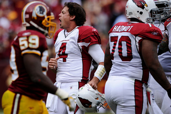 LANDOVER, MD - SEPTEMBER 18: Quarterback Kevin Kolb #4 of the Arizona Cardinals celebrates after throwing a touchdown and having his helmet knocked off against the Washington Redskins in the fourth quarter at FedExField on September 18, 2011 in Landover,