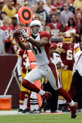 LANDOVER, MD - SEPTEMBER 18: Wide receiver  Larry Fitzgerald #11 of the Arizona Cardinals catches a pass and runs for a toucdhown against the Washington Redskins during the second half at FedExField on September 18, 2011 in Landover, Maryland. Washington