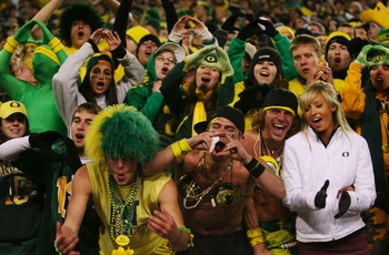 EUGENE,OR - DECEMBER 03:  Fans of the Oregon Ducks cheer on their team during the game against Oregon State Beavers at Autzen Stadium on December 3, 2009 in Eugene, Oregon. (Photo by Tom Hauck/Getty Images)