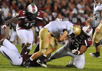 COLUMBIA, SC - SEPTEMBER 17:  Defensive tackle Travian Robertson #42 of the South Carolina Gamecocks sacks quarterback Kriss Proctor #2 of Navy Midshipmen September 17, 2011 at Williams-Brice Stadium in Columbia, South Carolina.  (Photo by Al Messerschmid