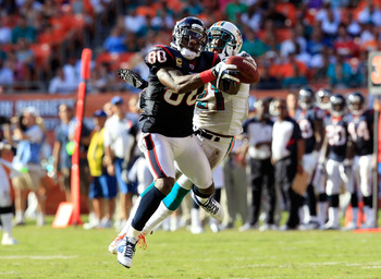 MIAMI GARDENS, FL - SEPTEMBER 18:  Houston Texans wide receiver Andre Johnson #80 attempts to make a reception against Miami Dolphins cornerback Vontae Davis #21 during a game at Sun Life Stadium on September 18, 2011 in Miami Gardens, Florida.  (Photo by