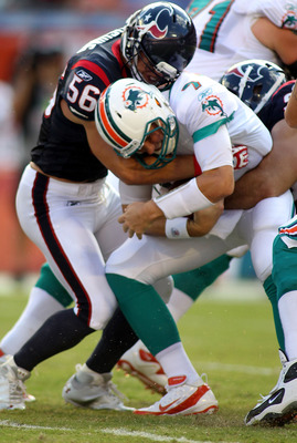 MIAMI GARDENS, FL - SEPTEMBER 18:  Linebackers Brian Cushing #56 and Connor Barwin #98 of the Houston Texans sack Quarterback Chad Henne #7 of  the Miami Dolphins at Sun Life Stadium on September 18, 2011 in Miami Gardens, Florida.  (Photo by Marc Serota/