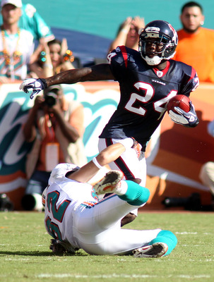 MIAMI GARDENS, FL - SEPTEMBER 18: Defensive back Johnathan Joseph #24 of the Houston Texans intercepts the ball in front of Receiver Brian Hartline #82 of the Miami Dolphins at Sun Life Stadium on September 18, 2011 in Miami Gardens, Florida.  (Photo by M