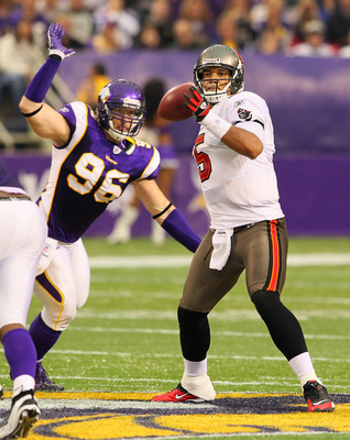 MINNEAPOLIS, MN - SEPTEMBER 18:  (L-R)  Brian Robison #96 of the Minnesota Vikings tries to sack Josh Freeman #5 of the Tampa Bay Buccaneers looks to pass at the Hubert H. Humphrey Metrodome on September 18, 2011 in Minneapolis, Minnesota.  (Photo by Adam