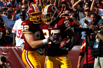 LANDOVER, MD - SEPTEMBER 11:  (R-L) Running back Tim Hightower #25 of the Washington Redskins celebrates with teammate Logan Paulsen #82 after scoring on a one-yard touchdown run in the second quarter against the New York Giants at FedExField on September