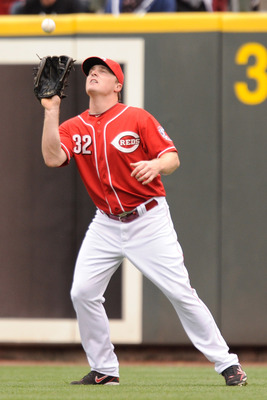 CINCINNATI, OH - SEPTEMBER 18:  Jay Bruce #32 of the Cincinnati Reds makes a catch in the outfield for an out against the Milwaukee Brewers at Great American Ball Park on September 18, 2011 in Cincinnati, Ohio.  Milwaukee defeated Cincinnati 8-1 to comple