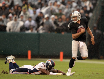 OAKLAND, CA - DECEMBER 19:  Jason Campbell #8 of the Oakland Raiders escapes a diving Jason Hunter #52 of the Denver Broncos at Oakland-Alameda County Coliseum on December 19, 2010 in Oakland, California.  (Photo by Ezra Shaw/Getty Images)