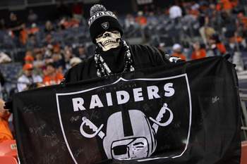 DENVER, CO - SEPTEMBER 12:  An Oakland Raiders fan holds up a flag before the Raiders take on the Denver Broncos at Invesco Field at Mile High on September 12, 2011 in Denver, Colorado.  (Photo by Doug Pensinger/Getty Images)