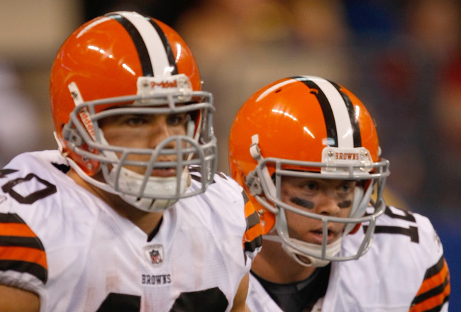 INDIANAPOLIS, IN - SEPTEMBER 18: Peyton Hillis #40 of the Cleveland Browns is congratulated by Colt McCoy #12 after scoring a touchdown as they run off the field during the game against the Indianapolis Colts at Lucas Oil Stadium on September 18, 2011 in