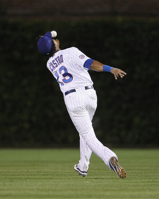 CHICAGO, IL - AUGUST 23: Starlin Castro #13 of the Chicago Cubs makes an over-the-shoulder catch of a fly ball against the Atlanta Braves at Wrigley Field on August 23, 2011 in Chicago, Illinois. The Braves defeated the Cubs 5-4. (Photo by Jonathan Daniel