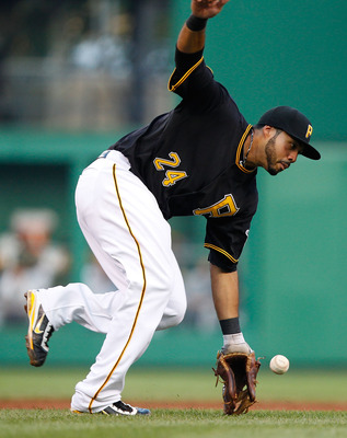 PITTSBURGH - AUGUST 05:  Pedro Alvarez #24 of the Pittsburgh Pirates misplays a ground ball in the infield against the San Diego Padres during the game on August 5, 2011 at PNC Park in Pittsburgh, Pennsylvania.  (Photo by Jared Wickerham/Getty Images)