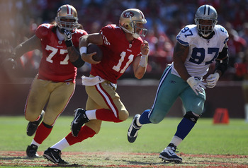 SAN FRANCISCO, CA - SEPTEMBER 18:   Alex Smith #11 of the San Francisco 49ers runs with the ball against Jason Hatcher #97 of the Dallas Cowboys at Candlestick Park on September 18, 2011 in San Francisco, California.  (Photo by Jed Jacobsohn/Getty Images)
