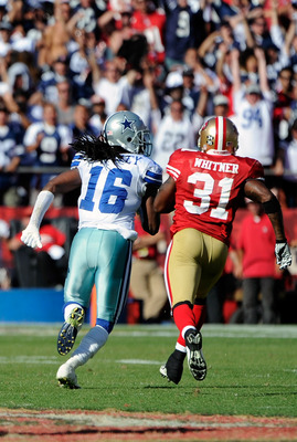 SAN FRANCISCO, CA - SEPTEMBER 18: Jesse Holley #16 of the Dallas Cowboys goes 77 yards on a pass play chased by Donte Whitner #31 of the San Francisco 49ers down to the one yard line in overtime during an NFL football game at Candlestick Park on September