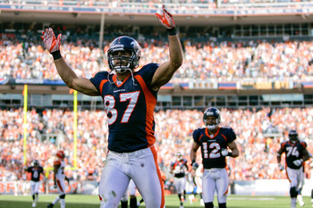 DENVER, CO - SEPTEMBER 18:  Wide receiver Eric Decker #87 of the Denver Broncos celebrates after scoring a 52-yard touchdown during the fourth quarter against the Cincinnati Bengals at Sports Authority Field at Mile High on September 18, 2011 in Denver, C