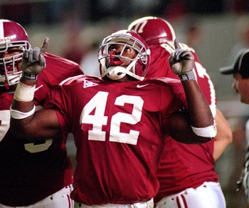 14 Oct 2000: Brandon Miree #42 of the Alabama Crimson Tide celebrates on the field with his teammates during the game against the Mississippi Rebels at the Bryant-Denny Stadium in Tuscaloosa, Alabama. The Crimson Tide defeated the Rebels 45-7.Mandatory Cr