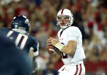 TUCSON, AZ - SEPTEMBER 17:  Quarterback Andrew Luck #12 of the Stanford Cardinal drops back to pass during the college football game against the Arizona Wildcats at Arizona Stadium on September 17, 2011 in Tucson, Arizona. The Cardinal defeated the Wildca