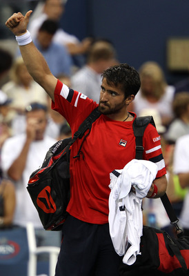 NEW YORK, NY - SEPTEMBER 08:  Janko Tipsarevic of Serbia waves to the crowd after losing to Novak Djokovic of Serbia on Day Eleven of the 2011 US Open at the USTA Billie Jean King National Tennis Center on September 8, 2011 in the Flushing neighborhood of