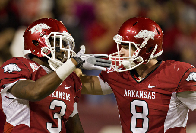FAYETTEVILLE, AR - SEPTEMBER 17:  Joe Adams #3 and Tyler Wilson #8 of the Arkansas Razorbacks celebrate after a touchdown against the Troy Trojans at Donald W. Reynolds Razorback Stadium on September 17, 2011 in Fayetteville, Arkansas.  The Razorbacks won