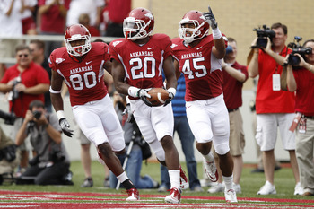 FAYETTEVILLE - SEPTEMBER 25: Ronnie Wingo Jr. #20 of the Arkansas Razorbacks celebrates with teammates D.J. Williams #45 and Chris Gragg #80 after a first half touchdown against the Alabama Crimson Tide at Donald W. Reynolds Razorback Stadium on September