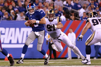 EAST RUTHERFORD, NJ - SEPTEMBER 19:  Eli Manning #10 of the New York Giants is sacked by Chris Long #91 of the St. Louis Rams at MetLife Stadium on September 19, 2011 in East Rutherford, New Jersey.  (Photo by Nick Laham/Getty Images)