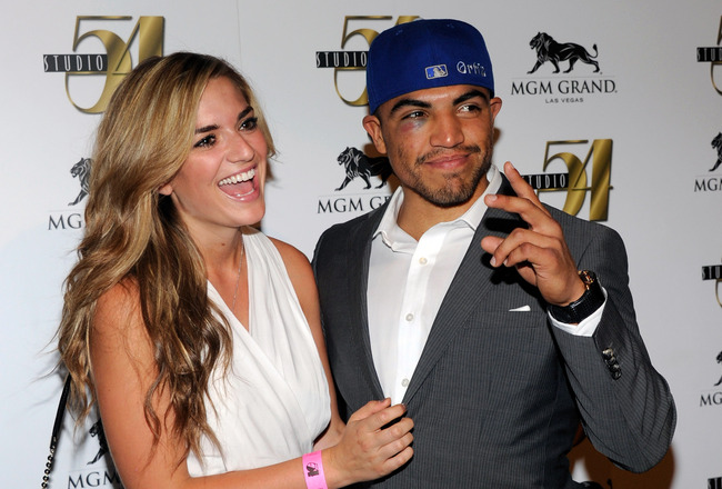 LAS VEGAS, NV - SEPTEMBER 18:  Boxer Victor Ortiz (R) and his girlfriend Alexia Garland arrive at a post-fight party at Studio 54 inside the MGM Grand Hotel/Casino early on September 18, 2011 in Las Vegas, Nevada. Ortiz lost the WBC welterweight title to
