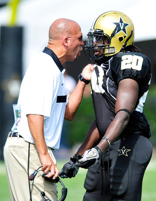 NASHVILLE, TN - SEPTEMBER 17:  Coach James Franklin makes a point to Micah Powell #20 of the Vanderbilt Commodores during a win against the Ole Miss Rebels at Vanderbilt Stadium on September 17, 2011 in Nashville, Tennessee. Vanderbilt won 30-7.  (Photo b