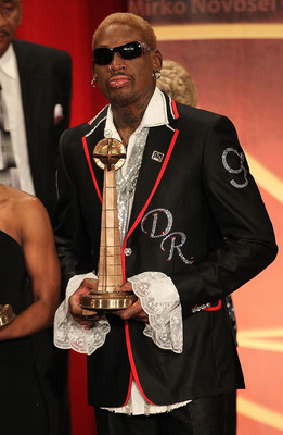 SPRINGFIELD, MA - AUGUST 12:   Dennis Rodman poses with his award during the Basketball Hall of Fame Enshrinement Ceremony at Symphony Hall on August 12, 2011 in Springfield, Massachusetts. (Photo by Jim Rogash/Getty Images)