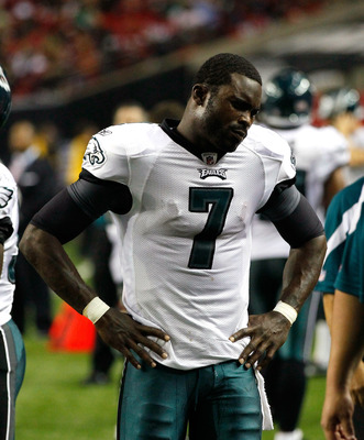 ATLANTA, GA - SEPTEMBER 18:  Michael Vick #7 of the Philadelphia Eagles stands on the sidelines after being injured in the third quarter against the Atlanta Falcons at Georgia Dome on September 18, 2011 in Atlanta, Georgia.  (Photo by Kevin C. Cox/Getty I