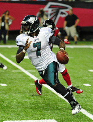 ATLANTA - SEPTEMBER 18: Michael Vick #7 of the Philadelphia Eagles scrambles against the Atlanta Falcons at the Georgia Dome on September 18, 2011 in Atlanta, Georgia. (Photo by Scott Cunningham/Getty Images)