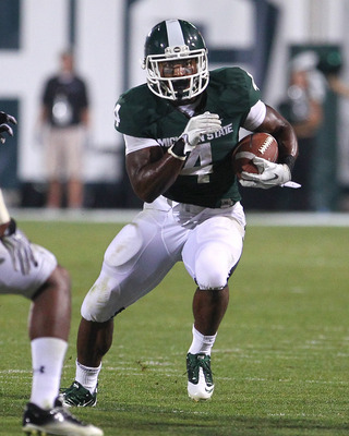 EAST LANSING, MI - SEPTEMBER 02:  Edwin Baker #4 of the Michigan State Spartans runs with the ball during an NCAA football game against the Youngstown State Penguins at Spartan Stadium on September 2, 2011 in East Lansing, Michigan. The Spartans won 28-6