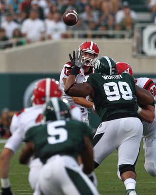 EAST LANSING, MI - SEPTEMBER 02:  Kurt Hess #12 of Youngstown State Penguins passes the ball against the Michigan State Spartans during a NCAA Football game at Spartan Stadium on September 2, 2011 in East Lansing, Michigan.  The Spartans won 28-6  (Photo