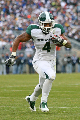 STATE COLLEGE, PA - NOVEMBER 27: Running back Edwin Baker #4 of the Michigan State Spartans carries the ball during a game against the Penn State Nittany Lions on November 27, 2010 at Beaver Stadium in State College, Pennsylvania. The Spartans won 28-22.(