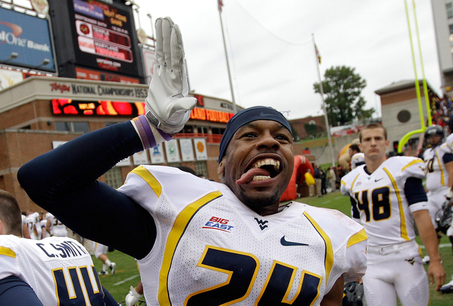 COLLEGE PARK, MD - SEPTEMBER 17: Eain Smith #24 of the West Virginia Mountaineers celebrates after defeating the Maryland Terrapins 37-31 at Byrd Stadium on September 17, 2011 in College Park, Maryland.  (Photo by Rob Carr/Getty Images)