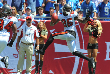 TAMPA, FL - SEPTEMBER 11:  Cornerback Aquib Talib of the Tampa Bay Buccaneers celebrates after intercepting the ball and running it back for a 28 yard touchdown in the first quarter against the Detroit Lions September 11, 2011 at Raymond James Stadium in