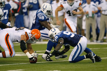 INDIANAPOLIS, IN - SEPTEMBER 18: Robert Mathis #98 of the Indianapolis Colts and Joe Thomas #73 of the Cleveland Browns reach for a fumbled football at Lucas Oil Stadium on September 18, 2011 in Indianapolis, Indiana. (Photo by Scott Boehm/Getty Images)