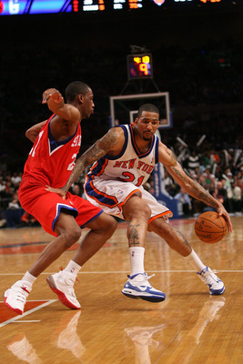 NEW YORK - OCTOBER 31:  Wilson Chandler #21 of the New York Knicks drives past Thaddeus Young #21 of the Philadelphia 76ers at Madison Square Garden on October 31, 2009 in New York City. The 76ers defeated the Knicks 141-127. NOTE TO USER: User expressly