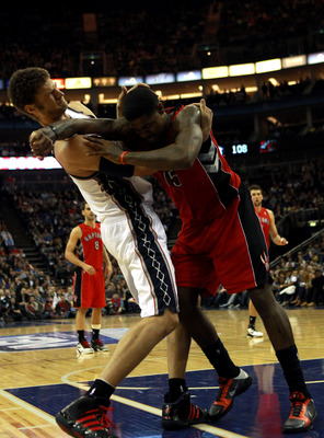 LONDON, ENGLAND - MARCH 04:  Tempers flare as Brook Lopez #11 of the Nets and Amir Johnson #15 of the Raptors clash during the NBA match between New Jersey Nets and the Toronto Raptors at the O2 Arena on March 4, 2011 in London, England. NOTE TO USER: Use