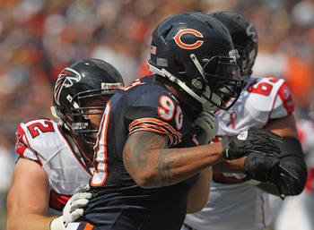 CHICAGO, IL - SEPTEMBER 11:  Julius Peppers #90 of the Chicago Bears rushes past Sam Baker #72 of the Atlanta Falcons at Soldier Field on September 11, 2011 in Chicago, Illinois. The Bears defeated the Falcons 30-12.  (Photo by Jonathan Daniel/Getty Image