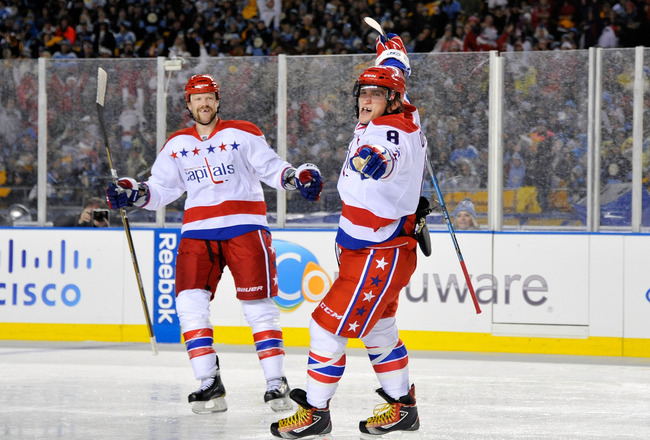 PITTSBURGH, PA - JANUARY 01:  Alex Ovechkin #8 of the Washington Capitals reacts to a shot on goal as teammate John Erskine #4 looks on during the third period of the 2011 NHL Bridgestone Winter Classic at Heinz Field on January 1, 2011 in Pittsburgh, Pen