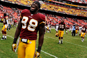 LANDOVER, MD - SEPTEMBER 18: Linebacker Brian Orakpo #98 of the Washington Redskins celebrates after defeating the Arizona Cardinals at FedExField on September 18, 2011 in Landover, Maryland. The Washington Redskins won, 22-21. (Photo by Patrick Smith/Get